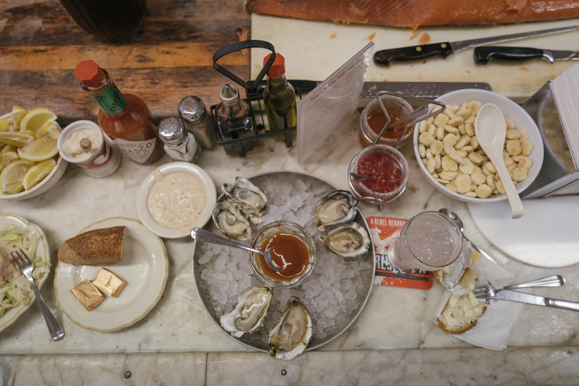 A Seafood spread at Swan oyster Co in San Francisco for Dirt Road Travels