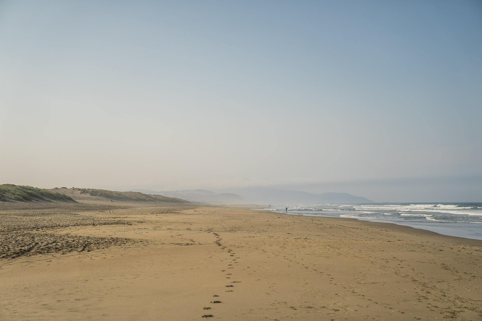 Ocean Beach with footprints in the sand in San Francisco.