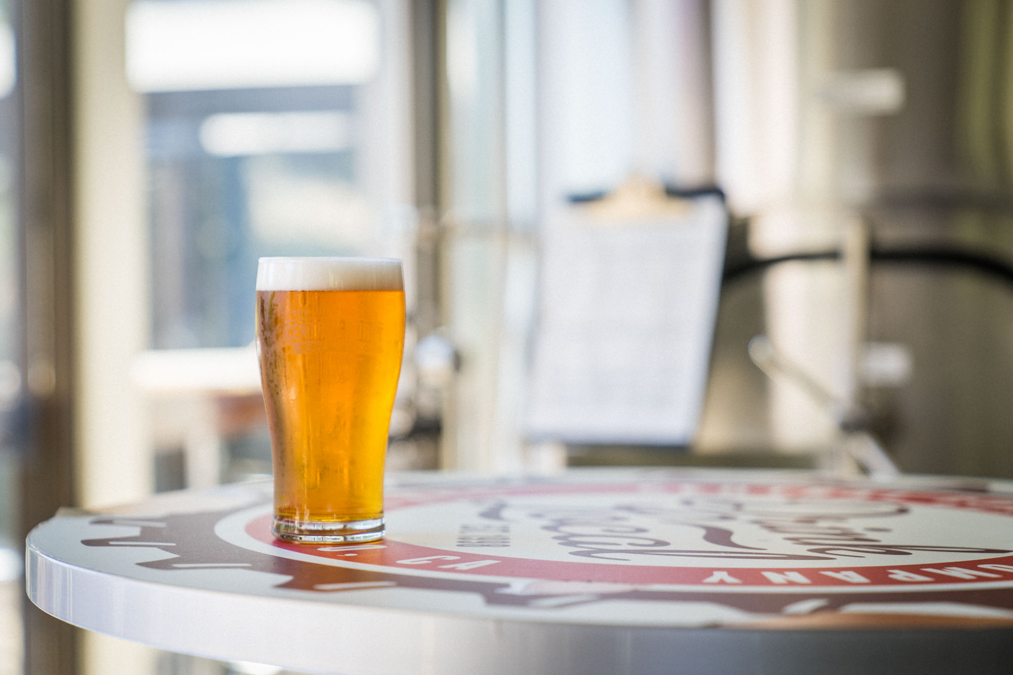 The Monterey Street Pale Ale beer sits on a table at Central Coast Brewing in San Luis Obispo for Dirt Road Travels