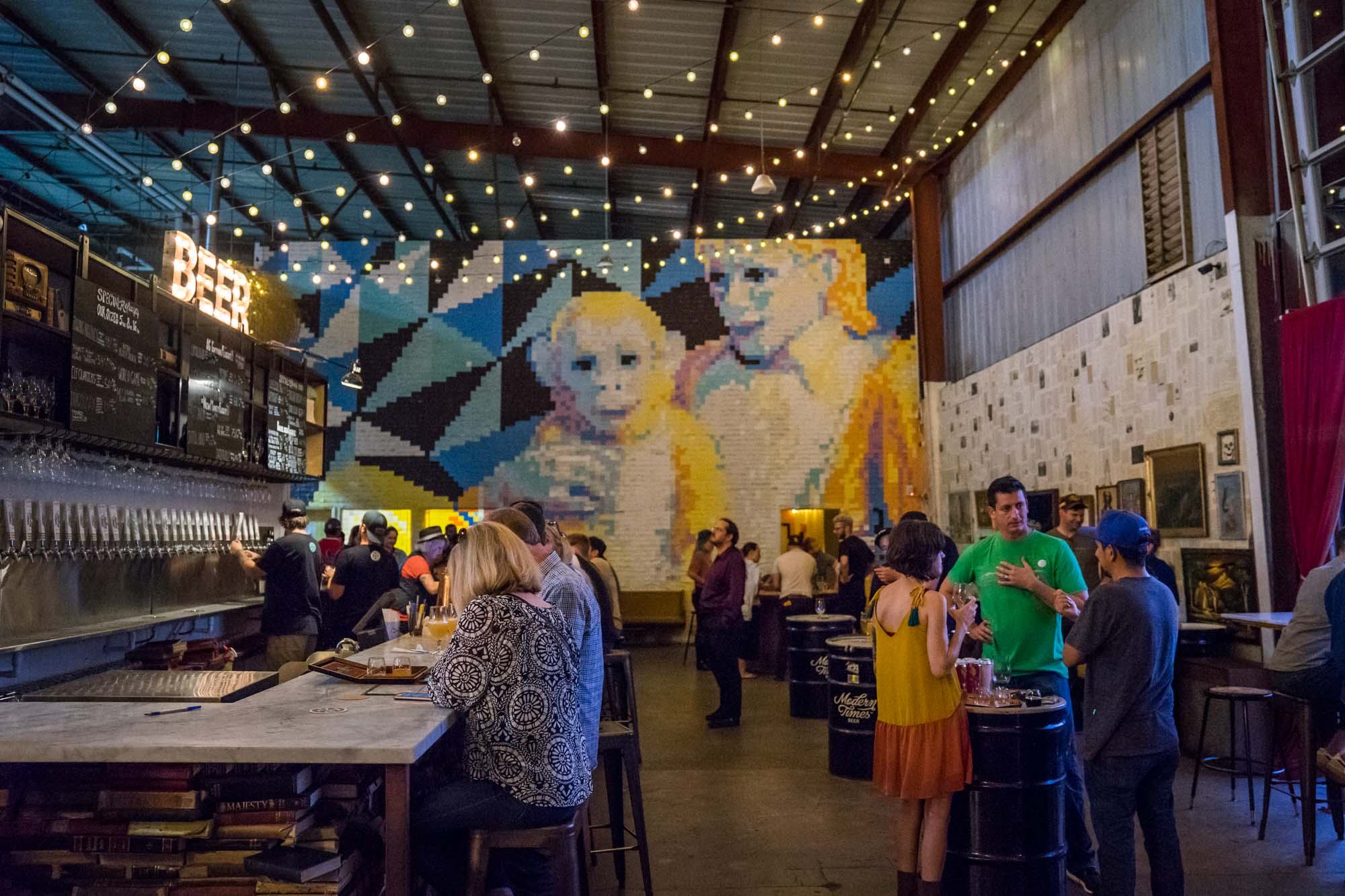 The main bar and mural at Modern Times Brewing in San Diego, California for Dirt Road Travels