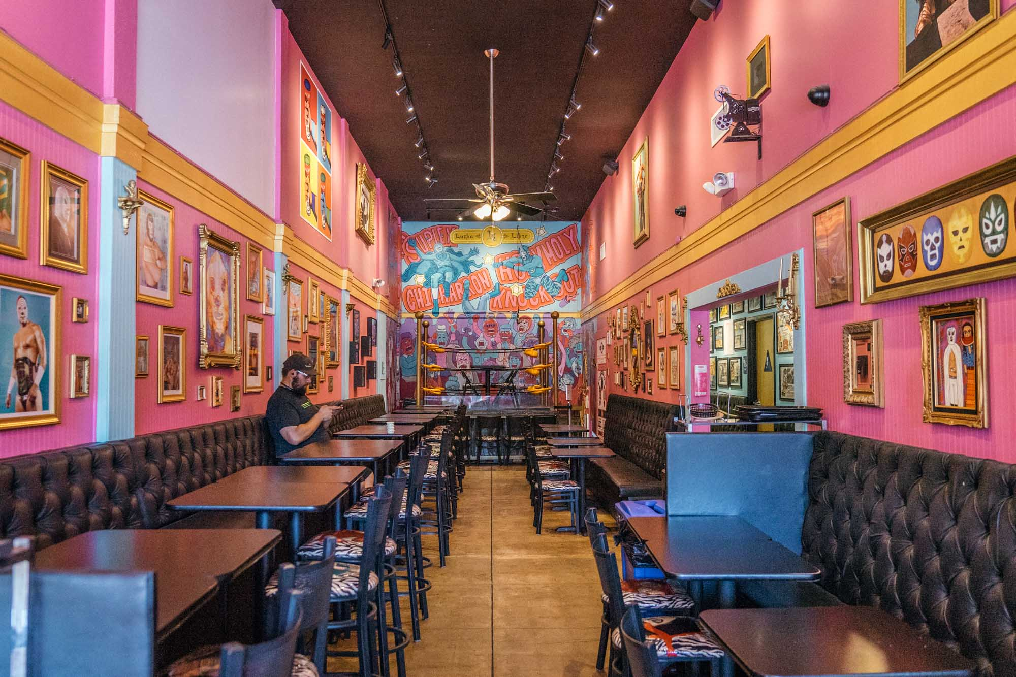 The pink interior of Lucha Libre restaurant in San Diego for Dirt Road Travels