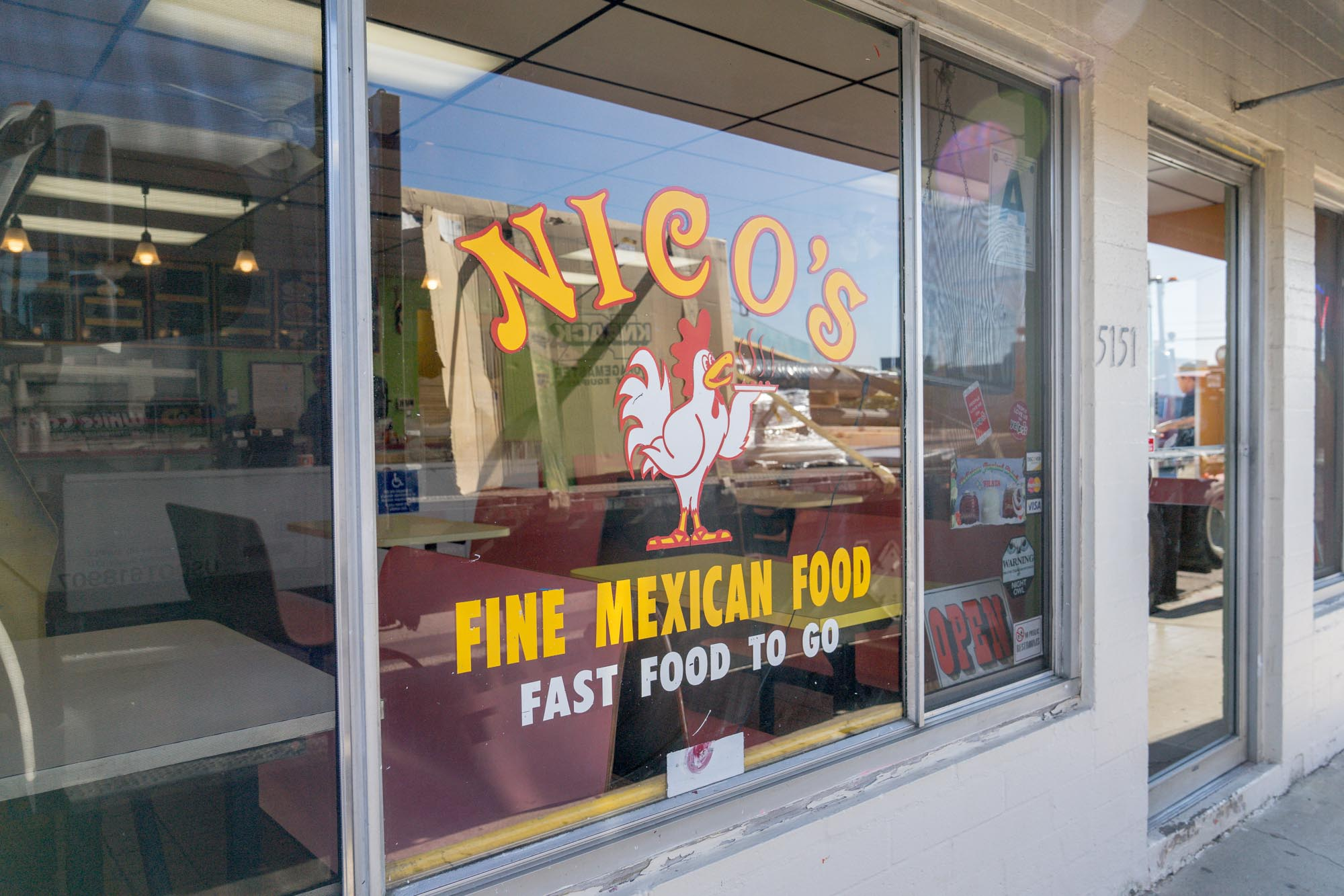 the sign for Nicos Mexican food in San Diego for Dirt Road Travels