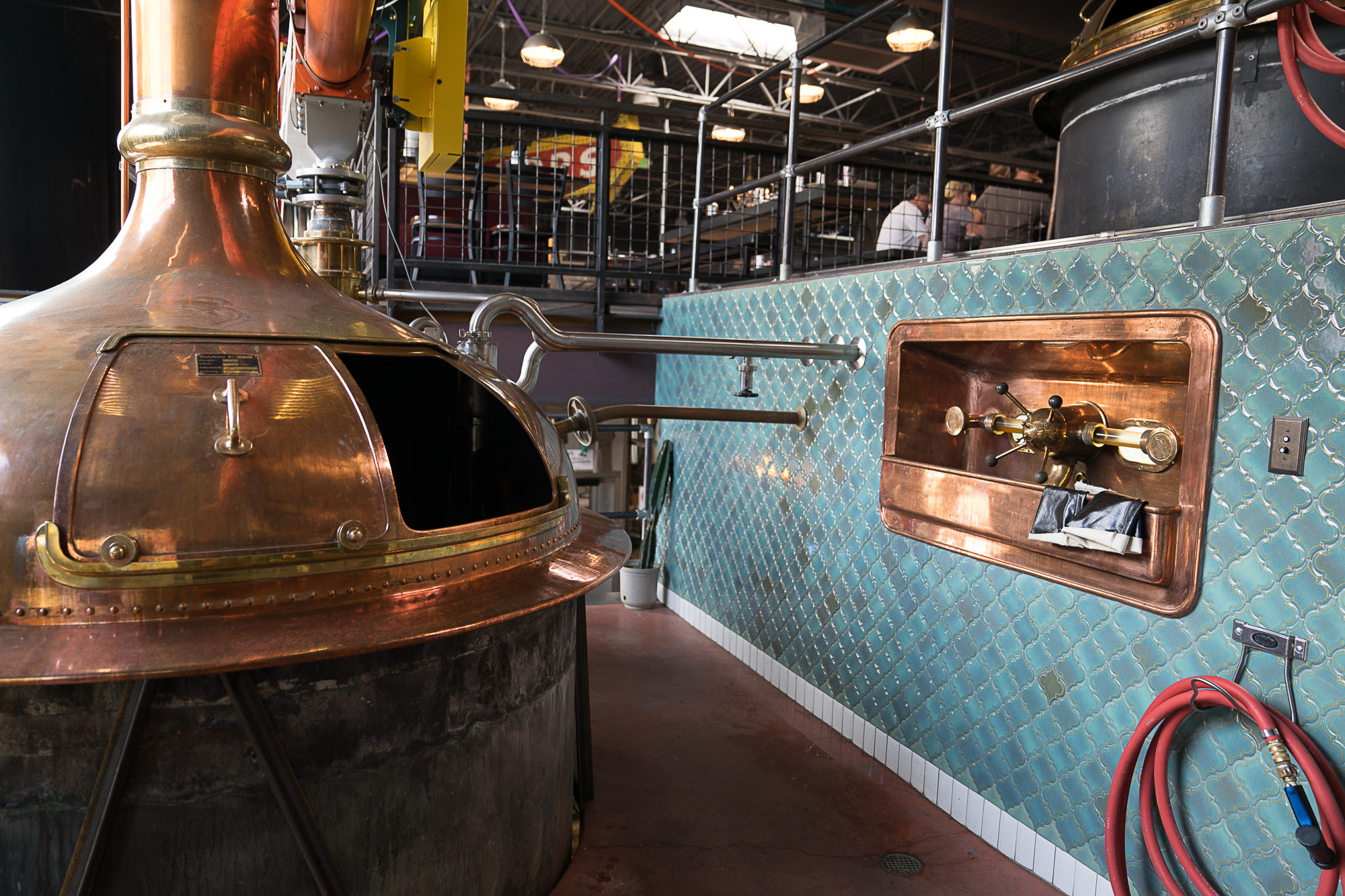The blue tile and copper vat at Bierstadt Brewing in Denver, Colorado for Dirt Road Travels