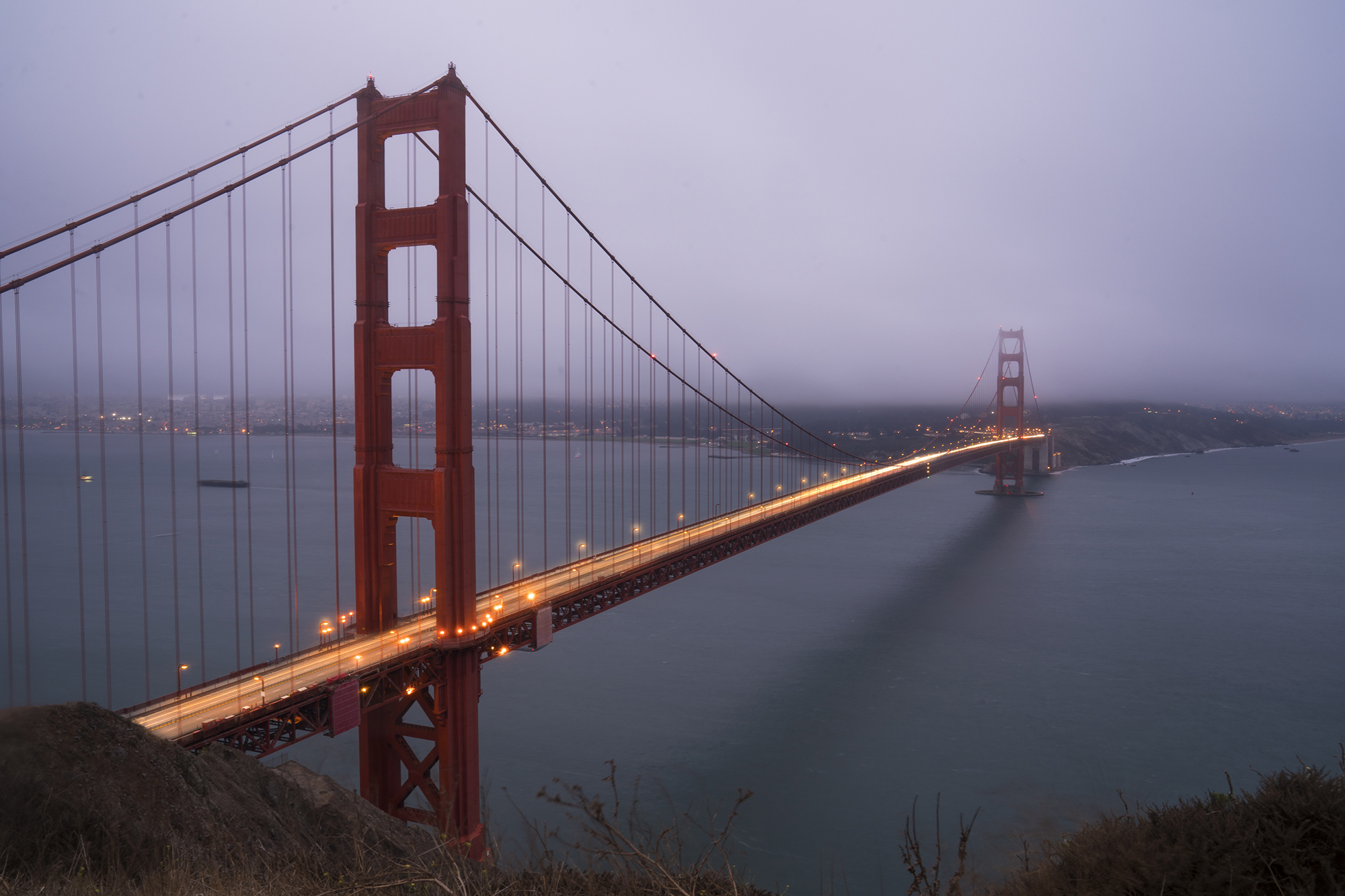 a view of the golden gate bridge during a foggy day in san francisco for dirt road travels