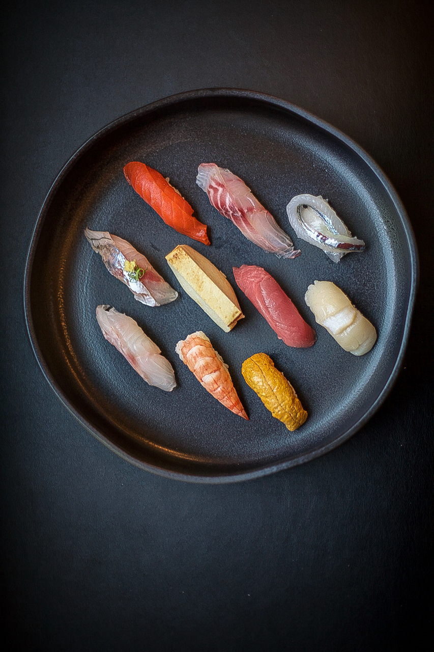 Chef Masayoshi creates edible art with sushi at Masayoshi Japanese restaurant in Vancouver, Canada for Dirt Road Travels