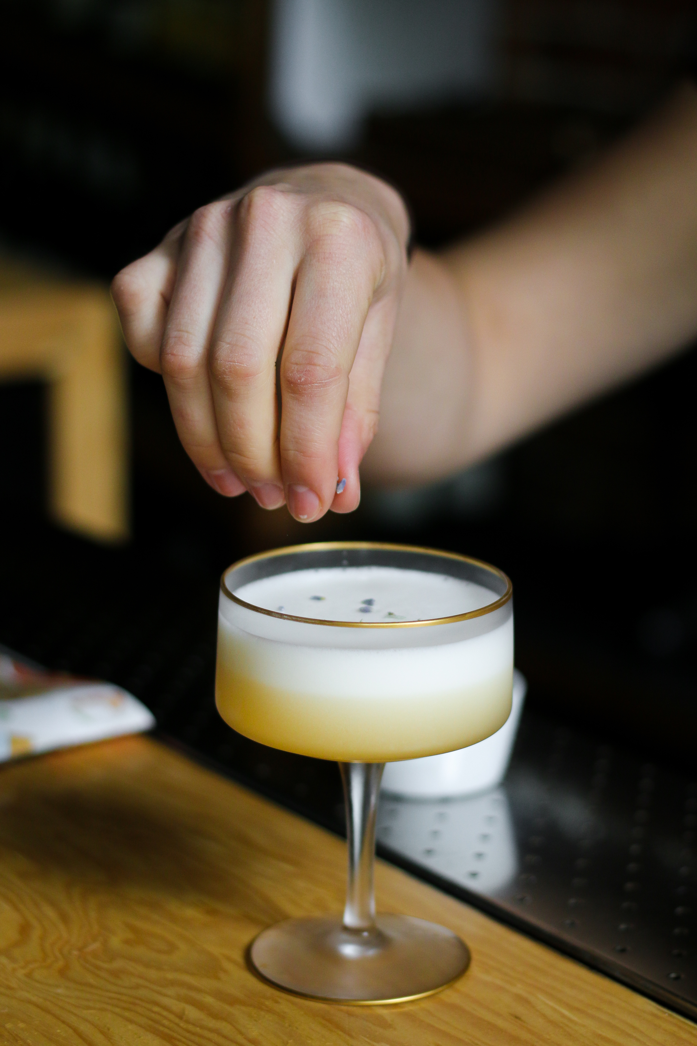 The bartender tops of an Earl Grey Martini at L'Abattoir in Vancouver British Columbia as part of a Dirt Road Travels city guide.