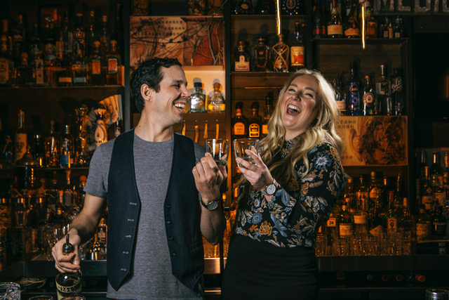 The bartenders laugh as they craft cocktails at the Keefer Bar in Vancouver British Columbia as part of the Dirt Road Travels city guide.