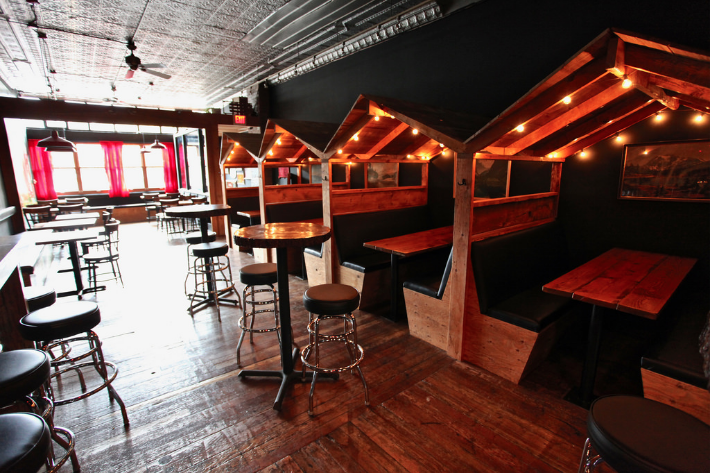 The Black Lodge has cabin roofed booths inside in Vancouver, British Columbia as part of Dirt Road Travels city guide.