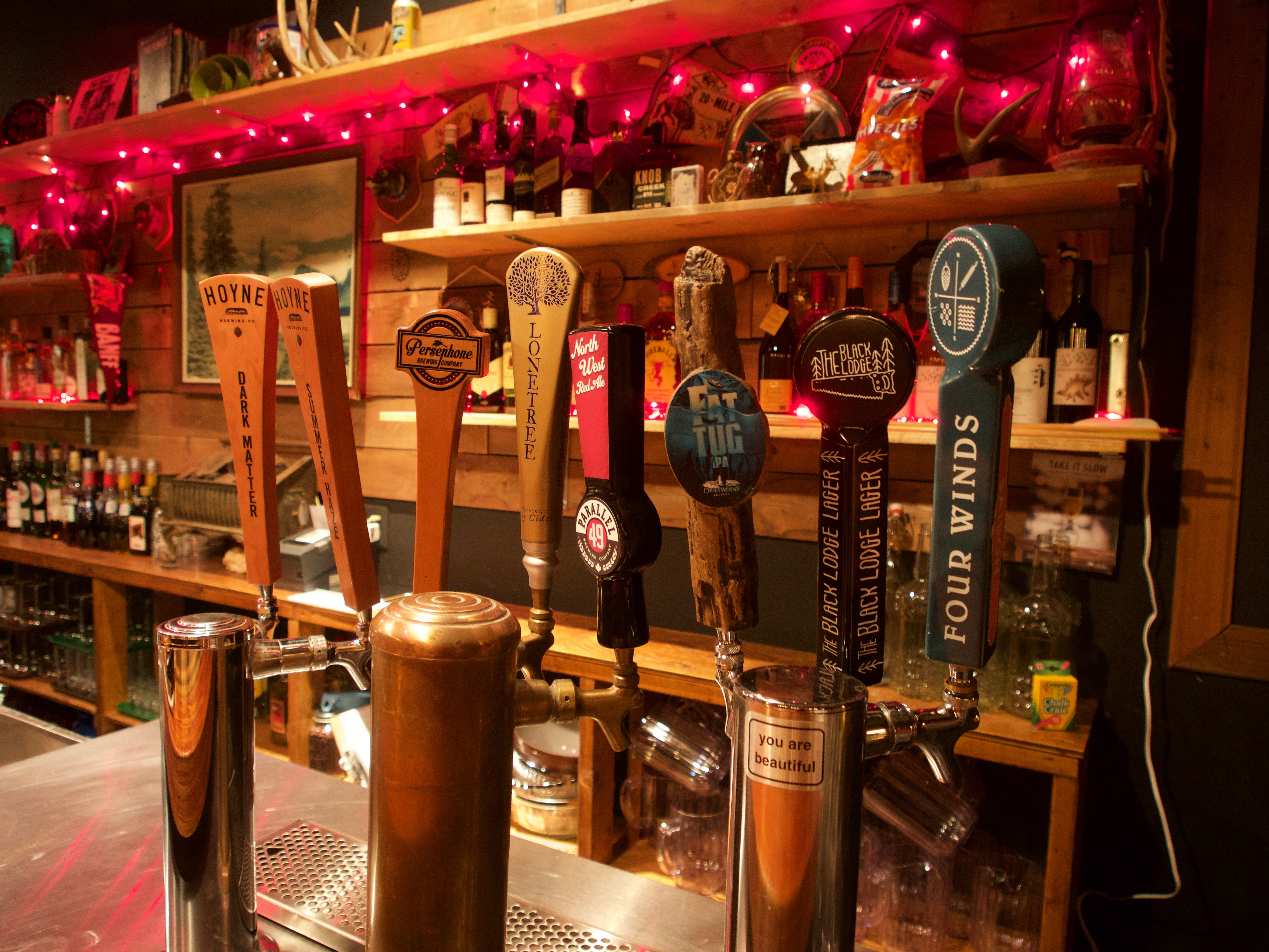 Beers on tap at the Black Lodge in Vancouver, British Columbia as part of the Dirt Road Travels city guide.