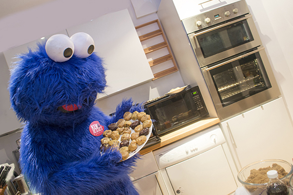 cookie monster holding cookie tray