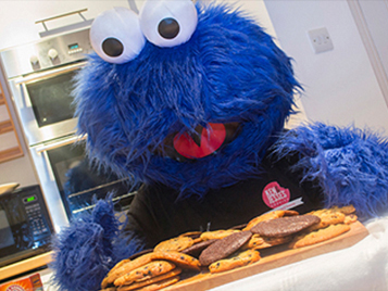 Cookie monster looking at cookies
