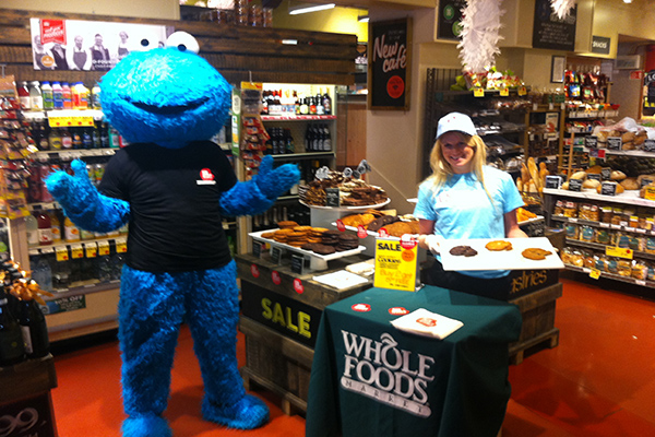 Cookie monster with lady at whole foods