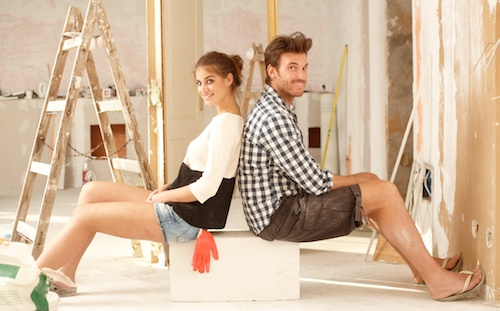 young couple taking a break from home remodel
