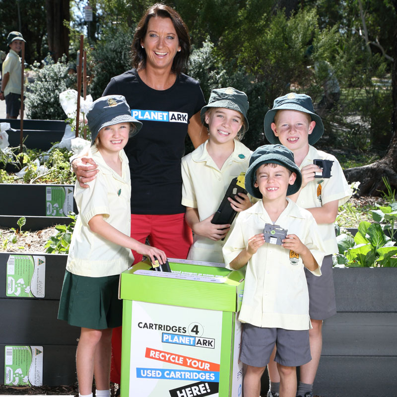 Layne Beachley helping students recycle right.