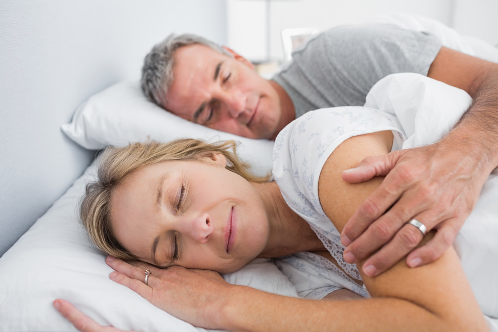 getting restful sleep with spouse from back and neck pain relief