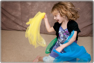 Photo of a young girl in a Kindermusik class