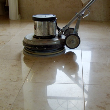 Tile and grout being cleaned