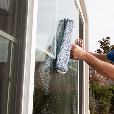 Window on a house in Tucson being cleaned