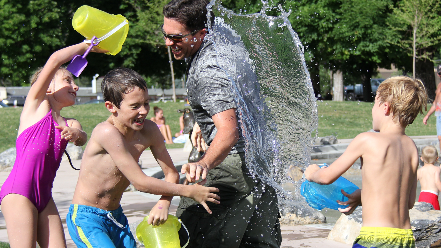 Water play outdoor with the kids on Family Day