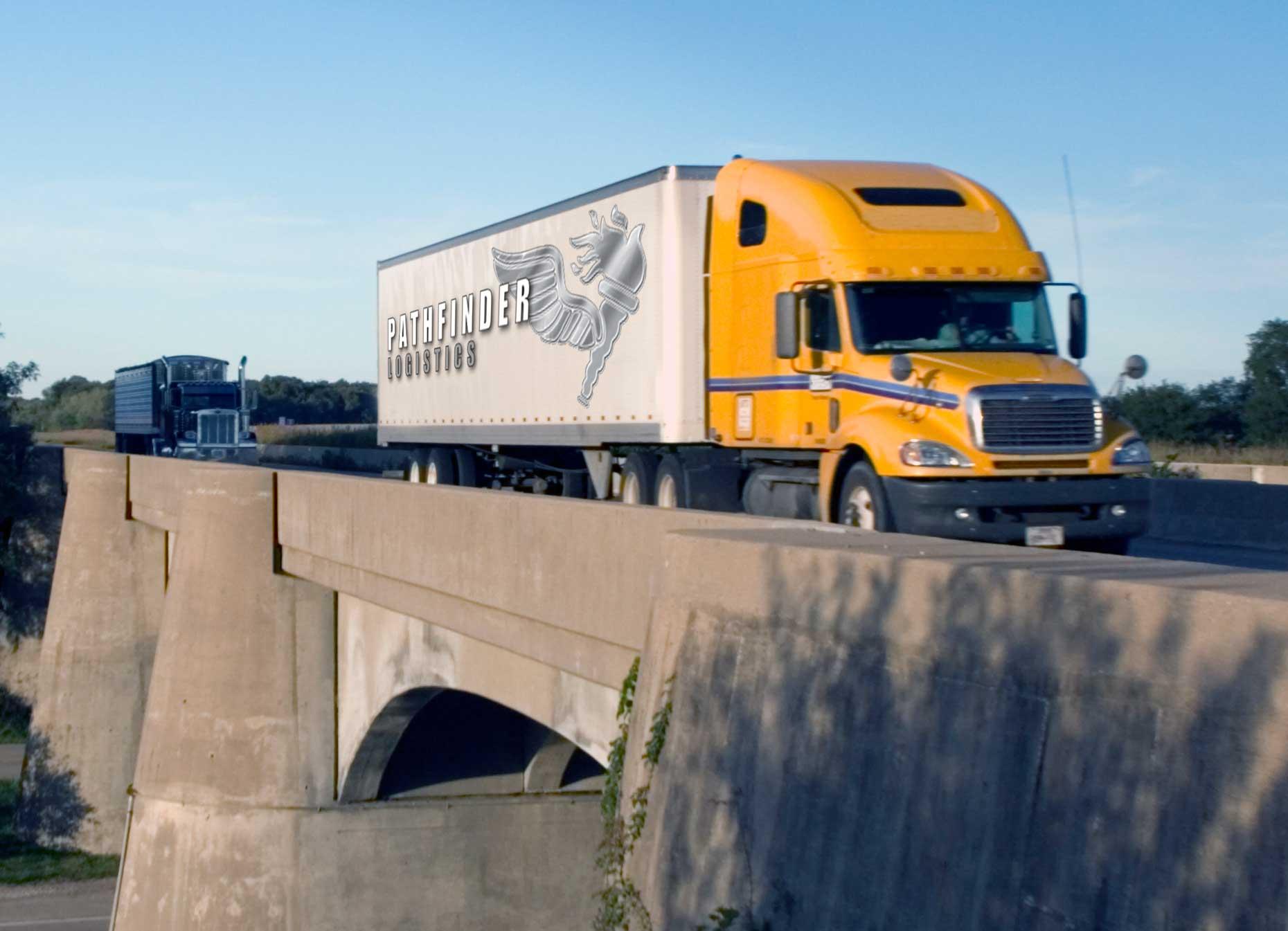 Photo of Pathfinder Logistics Truck Over A Bridge