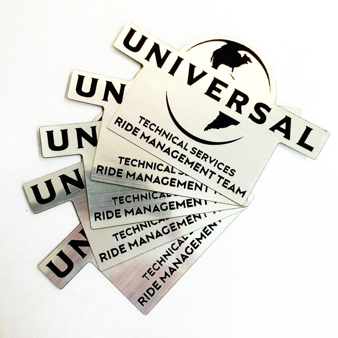 Employee badges laser cut and etched from 2 color acrylic plastic for Universal Studios