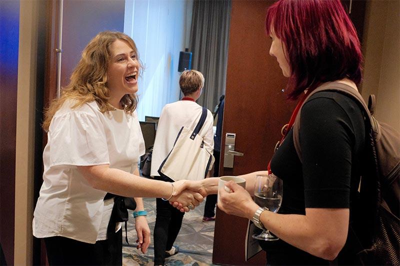 Speaker Ahava Leibtag greets attendees
