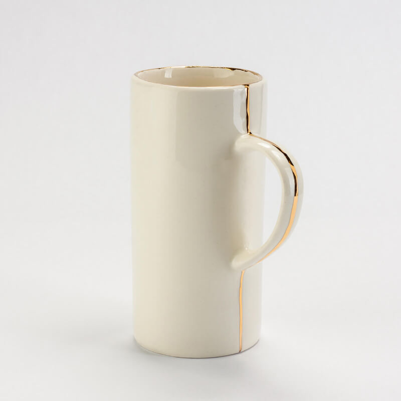 Photo of a ceramic cup with gold accents for their catalogue
