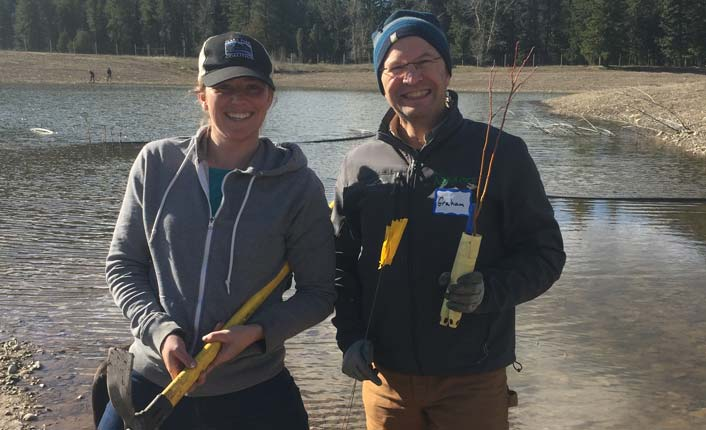 Lily Haines and Graham Roy show their enthusiasm about planting willow seedlings at Five Valleys Land Trust's wetland restoration site. Photo by Kurt Wilson and the Missoulian.