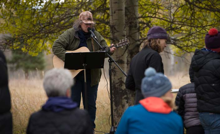 Grand Opening guests enjoyed hot cocoa, sandwiches and music by local guitarist Diane Krier. Photo by Chris Gibisch.